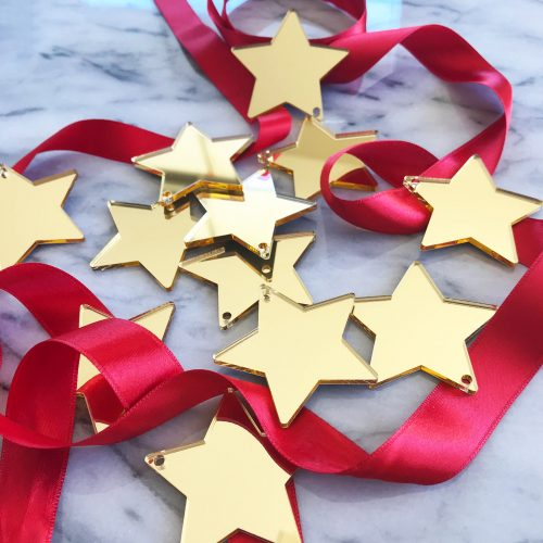 12 Shining Star Decorations in Gold Mirror